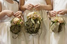 Rustic grapevine pomander balls accented with ivory garden roses for three adorable flower girls.