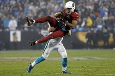 Larry Fitzgerald has only dropped 25 passes in his entire year. Look as he displays his great hands in this picture.
