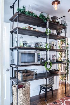 Industrial open shelving for kitchen or any space. Love the use of it here. Would work great in a coastal beach home or any style home.
