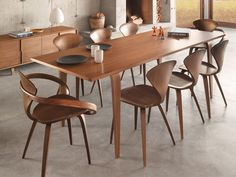 The 1958 moulded plywood side chair by Norman Cherner is the companion to the classic Cherner armchair.