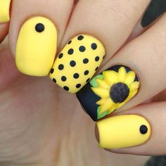 Matte-y Black and Yellow Sunflower Nail Art Design. Summer without yellow colors is not actually the summer. Add these yellow- colored sun flowers with the black polka dots to celebrate summer.