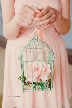 bird cages with flowers for my flower girls.