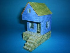 This little house is part of a series six miniature architectural paper models. Download all at Papermau!