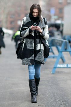 Incredible Model Street Style Outfits From New York Fashion Week - black and white paid blanket coat + light wash skinny jeans and black winter boots