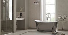 Fired Earths Moderna  Polished Le Bain de Bateau Bath with Avebury Bath/Shower Mixer, Architectural Stone Azul Delphi Basin, Madison Shower Enclosure with Low Profile Shower Tray.