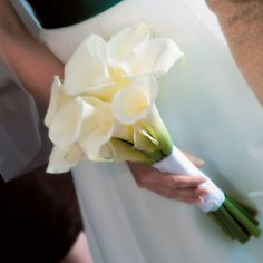 Gina carried a bouquet of white calla lilies tied with white ribbon.