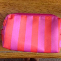 Pink & Orange Cosmetic Bag Brand new w/o tags. Made for makeup or change purse. No marks, tears, & rips. Target Bags Cosmetic Bags & Cases