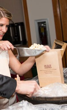 Stock your wedding reception popcorn bar with plenty of closeable tin tie favor bags personalized with a personal message from the bride and groom for guests to fill and snack on during the reception or take home to enjoy later. 6 x 9 Tin tie favor bags are the perfect size for candy buffets, donut walls and dessert bars as well. These favor and treat bags can be ordered at http://myweddingreceptionideas.com/personalized_large_tin_tie_goodie_bags.asp