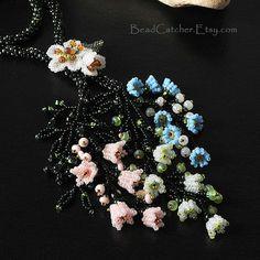 I love the cascading simple little herringbone flowers. By BeadCatcher on etsy.