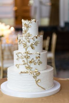 Chic white and gold wedding cake; Emilia Jane Photography; Via Elizabeth Anne Designs
