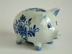 delft pottery   ... delft factories in holland had closed by 1800 but the royal delft......Late 40s and on to 80s Momma had a Pig collection/dkw