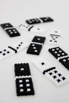 Diy Perler Bead Domino - We all have that one box of domino at home but have no idea where half of the dominos are, so we don't really play. But why not play this fun game by making your own domino. And the answer to how you can do that is by using black and white perler beads. Creating your own game has never been easier, and you can include the kids too, so have fun!