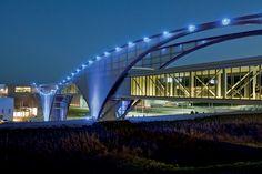 illuminated footbridge at the volkswagen production facility by SSOE group via designboom