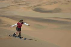 Sandboarding the dunes in Namibia
