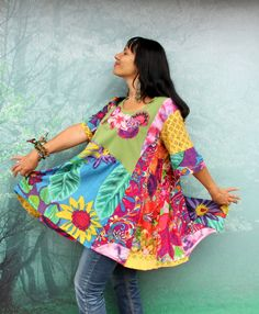 Crazy summer colors floral appliqued dress tunic. Made from recycled fabrics and recycled clothing. Remade, reused and upcycled. Fantasy design. Hippie boho floral style, magical patchwork. One of a kind. Size: L-XXL (european 40- 44) Bust line even 50 inches (127 cm) Hips line even 60 inches (150 cm) Length about 35 inches (89 cm)