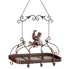 DSHD - Country Rooster Kitchen Rack Attractive overhead rack puts your pots and pans right within easy reach; a must-have for any serious chef! Jaunty rooster and scrollwork theme and rich rust-red finish add informal elegance to your kitchen. Rooster Kitchen Decor, Rooster Decor, Chicken Kitchen Decor, Rooster Plates, Rooster Art, Red Rooster, Pot Rack Hanging, Hanging Pots, Hanging Organizer