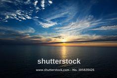 Sunset on the horizon at sea (Baltic Sea before Helsinki).