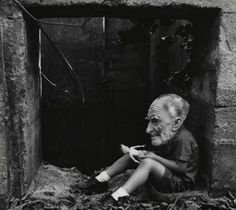 Ralph Eugene Meatyard, Untitled [Boy in Old Man's Mask with Doll] 1960