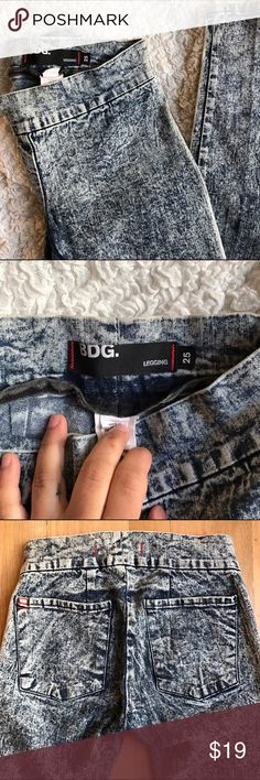 BDG acid wash low rise leggings Stretchy denim legging from urban outfitters BDG size 25. Mineral wash grungy legging, would pair well with a torn up band tee, leather jacket, and combat boots. No signs of damage or wear. BDG Pants Leggings