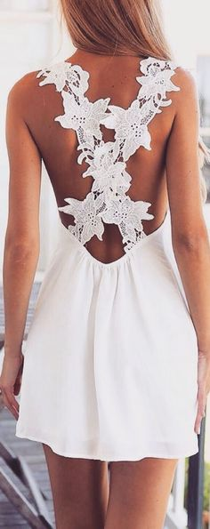 Short white dress with empty back. Sundresses!! Actually most dresses. Always feel so much better in a dress!