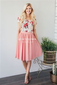 This skirt is oh-so-beautiful! We love the cute peachy pink spring color and the adorable ivory polka dots. Skirt is fully lined with back elastic waist and slips on.