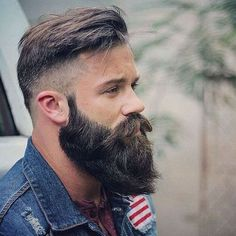 High Bald Fade with Textured Comb Over and Thick Beard