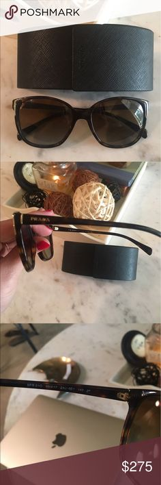 Prada sunglasses w/case Like new Pradas. Tortoiseshell design on the frames. Lens have slight gradient in tint and are polarized. No signs of wear or scratches. Bought them online and just don't like the way they fit my face. Comes with matching Prada case Prada Accessories Sunglasses