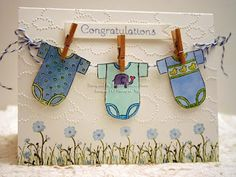 Stampin' Up! jumbo wheel for baby onesies colored in markers, Serene Silhouettes for flowers, grass is from retired Because of You, cloud embossing folder, clothespins and bakers twine to embellish. Congratulations sentiment is from Occasional Quotes.