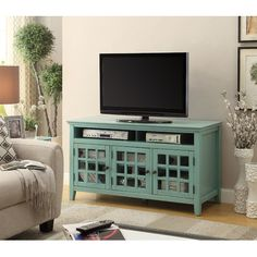 Shelf Thickness: Riverbay Furniture TV Stand in Distressed Antique Turquoise. Perfect for placing in a living room or bedroom, the cabinet features three doors, interior shelf and a glass front. My Living Room, Living Room Furniture, Blue Tv Stand, Cool Tv Stands, Wood Cabinets, Media Cabinets, Dark Cabinets, Repurposed Furniture, Furniture Ideas