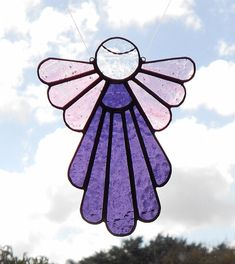 """Stained Glass Angel measures approx. 6"""" high x 5"""" wide.Stained Glass Stained Glass by BoxesandBeyond $26.00"""