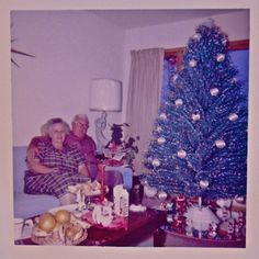 Vintage Christmas photo.with that tree it has to be from the 60's