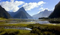 Milford Sound, New Zealand. Although I have to admit, the weather was more rainy, less..perfect..than the day this photographer got this shot!