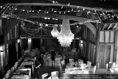 Crystal tiered chandeliers with fairy lights for a barn wedding at the Tudor Barn Burnham. Lighting by Oakwood Events