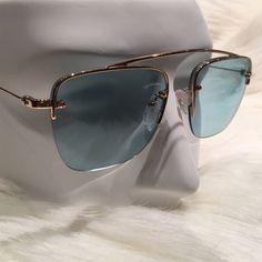 Prada aqua blue n gold aviators Brand new, never worn and comes with original case and sealed cloth. Super lightweight and very cool n sexy. Looks amazing with or without a hat. The case is alil banged up, from being in my Sunglass drawer with other cases and boxes but never wore the sunglasses, I wear prescription now so I will be selling a lot of my Sunglass collection. Bought at Neimans. No trades! Prada Accessories Sunglasses