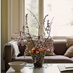 Blossom, pussy willow and tulips create a rustic Easter centerpiece.