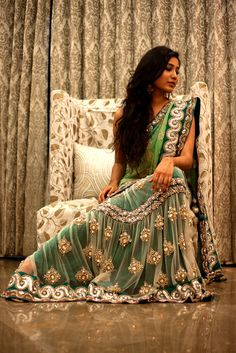 Teal green lengha from Izaya Couture.