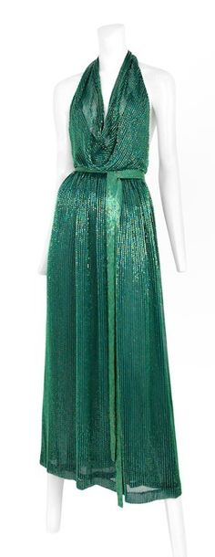 Vintage HALSTON emerald green bead encrusted halter gown with matching beaded belt.