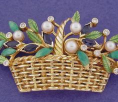 BROOCH: yellow gold, 11 diamonds 0,19 ct., 6 sapphires, 5 pearls and enamels. size: 27 x 46  mm..