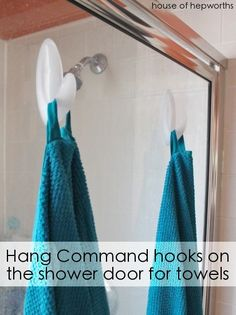bathroom storage ideas - stick command hooks to your shower door!
