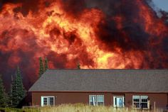 A wildfire burns near a home Sunday, Sept. 9, 2012 on Casper Mountain in Casper, Wyo. Residences and campgrounds were evacuated as the uncontained wildfire spread across the southeast portion of the mountain. Photo: The Casper Star-Tribune, Alan Rogers / AP