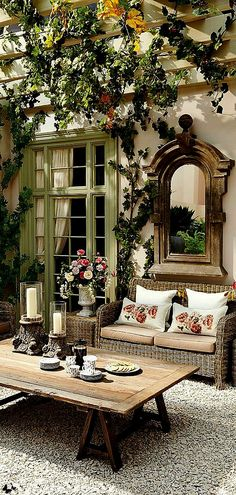 Fabulous Outdoor Room. Love the mirror!  Wicker couch.  French doors.