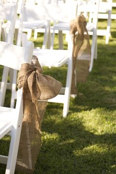 *Not burlap, but perhaps bows and flowers every other!    Burlap Bows| Photo: www.reesemooreweddings.com/
