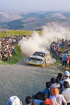 """Walter RöhrL and Navigator ChrisTiAn Geistdörfer manhandle an Audi SporT Quattro SI E2 during the 1985 Rallye Sanremo. """"Racing provides more than an adrenaline rush. It gives us hands-on experience to develop better cars. We'll see you at the track—and on the dirt roads!"""" — Akio Toyoda, President, Toyota Motor Corporation"""