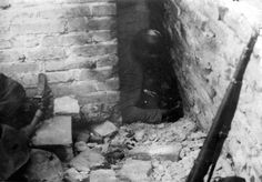 Warsaw, Poland, German soldiers discovering a bunker during the suppression of the Warsaw Ghetto Uprising, 1943.                          ...