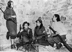 In November 1944, four female Italian anti-Fascist fighters relax as they await orders from their commander during their effort in support of Allied troops on the Castelluccio front.