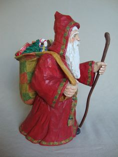 This woodcarving depicts a Medieval St Nicholas or Old world Santa Claus sometimes called Grandfather Frost. A handmade Christmas gift, it is an