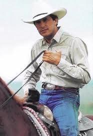 George Strait riding