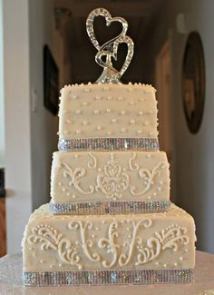 """Exploring the """"shapes"""" of cake i want, our big day is coming up quick! Different topper, different design, add some red dots, some grey trim we may have something magical :)"""