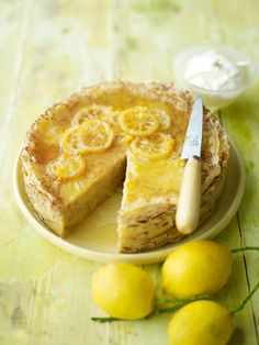 Lemon Crepe Cake - A little goes a long way with this stacked crêpe cake, topped with tangy candied lemon slices