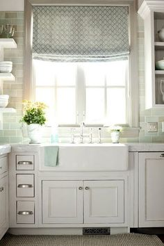Love the roman shade, subway tile, and sink.